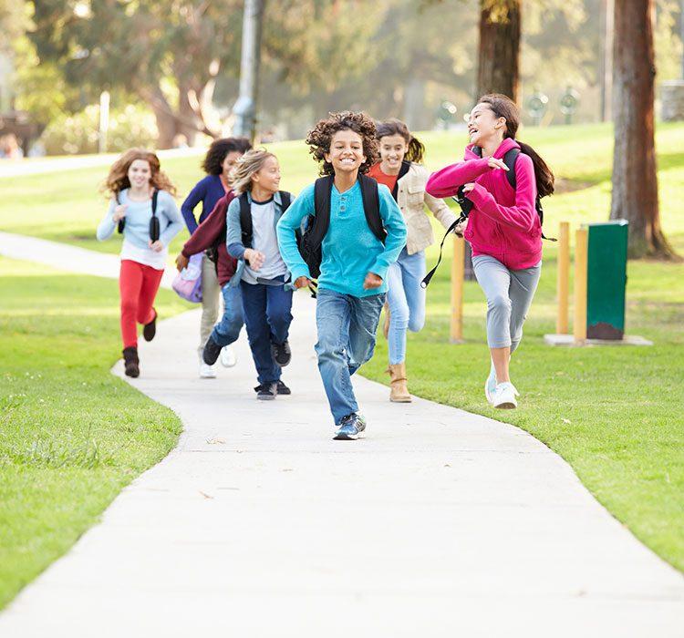 bigstock-Group-Of-Children-Running-Alon-92608610